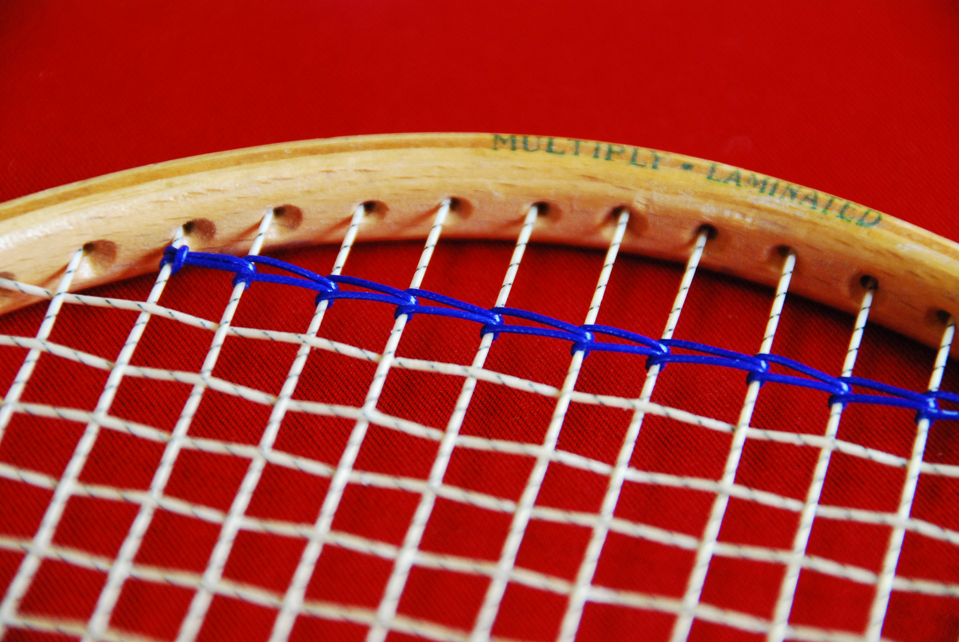 Untitled 1 in the old days with wooden rackets when 10 lbs or so of tension was tight a string was used at top and bottom of the racket to help keep the mains buycottarizona